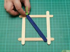 How to Build a Popsicle Stick Tower. Popsicle stick towers are a common engineering project to be assigned in school.Your assignment may have various criteria for height, weight, and number of popsicles, but this guide will give you a. Engineering Projects, Wood Glue, Popsicle Sticks, Diy Wood Projects, Popsicles, Tower, Tableware, Building, Image