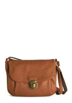 Spontaneous Sojourn Bag. For a trip to see the fantastic foliage across your state, grab this almond-brown cross-body bag and jump into your friends car! #tan #modcloth