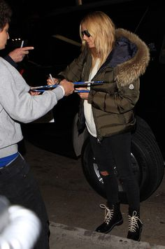 """Heidi Klum Wraps Up in Moncler Parka and Rag & Bone """"Emil"""" Combat Boots at LAX"""