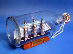 USS Constitution Model Ship in a Glass Bottle from Handcrafted Nautical Decor Model Ship Kits, Model Ships, Nautical Gifts, Nautical Theme, Uss Constitution Model, Boat In A Bottle, Nautical Home Decorating, Decorating Ideas, Wood Boats