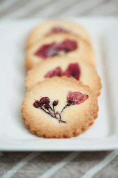 I like the idea of edible flowers on sugar cookies:  Sakura Cookies (Bicil the Baker)