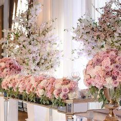 Pastel roses + mirrored furniture = head table goals