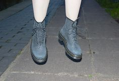 Jess from Dr. Martens Marketing Team wearing the Python 1460 Boots.