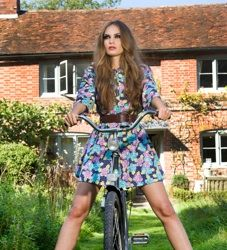 #Editorialfashionshoot outdoors #modelONbicycle #cateyemakeup #strongeyemakeup #longhair makeup garden