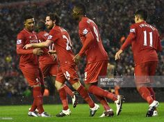 Liverpool's Welsh midfielder Joe Allen (2L) celebrates after scoring during the English Premier League football match between Liverpool and Arsenal at Anfield stadium in Liverpool, north-west England on January 13, 2016. ELLIS