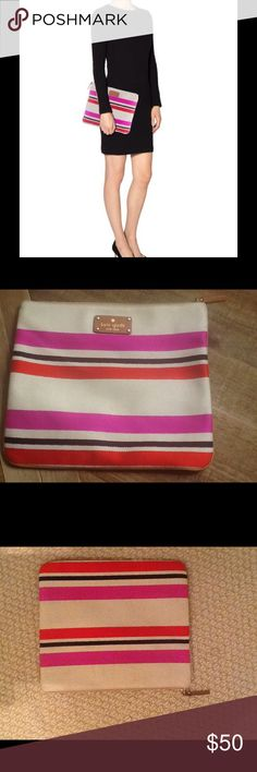 """Kate Spade New York Clutch New York Beige with stripes clutch. Never used  dimensions are: 12""""L X 10""""H X .05W.           Magenta, red and black striped canvas. Zip pouch closure with caramel leather trim.  Beige lining with dual pockets kate spade Bags Clutches & Wristlets"""