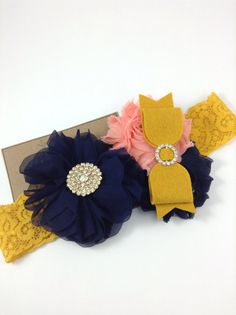A Gorgeous Headband, perfect for Fall Days!    A Golden Mustard Lace Headband complimented with a Navy Ballerina Flower with a gold rhinestone center