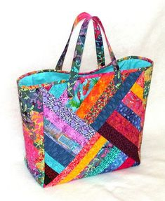 Quilted Strings Patchwork Tote by AllThatPatchworkQuilted Strings Patchwork Tote - just a picture for reference - no instructionsLooking for quilting project inspiration? Check out Bright Strings Quilted Tote Bag by member AllThatPatchwor. Quilted Tote Bags, Patchwork Bags, Patchwork Quilting, Quilted Gifts, Diy Quilt, Quilt Bag, Bag Patterns To Sew, Quilted Purse Patterns, Patchwork Patterns