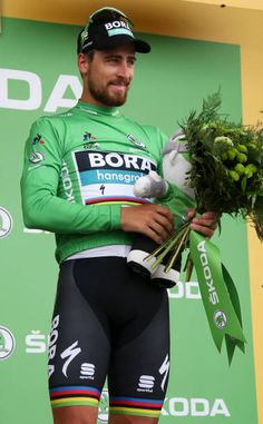 Peter Sagan of Slovakia and Team BoraHansgrohe retains the green jersey of best sprinter on the podium following stage 13th of Le Tour de France 2018...