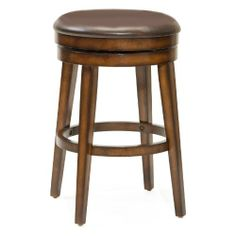 Hillsdale Furniture Beechland Backless Swivel Bar Stool by Hillsdale Furniture. $149.00. Other Dimensions 30.5 in. Seat Height. Rustic Oak. Style Traditional. Assembled dimensions 30.5 in. H x 20 in. W x 20 in. D. Sometimes the simple and traditional ways are best and that is evident in Hillsdale Furniture's Beechland swivel stool. A backless swivel stool with sturdy tapered legs and an ample brown vinyl seat this stool is taken from plain to posh by it's unique rustic oak fi...