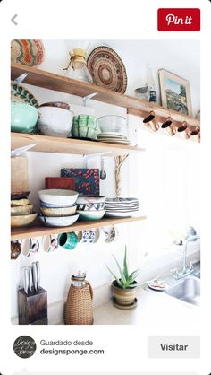Love the natural wood shelves and mixed dishes/pottery