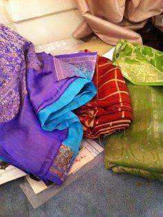 New batch of saris. Off to do burn tests! Saris, Suitcase, Suitcases, Saree, Briefcase, Sari Dress