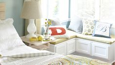 Corner Bench Seat    Lowe's Creative Ideas Use stock cabinets to build a simple DIY window seat and transform any corner into a cozy bedroom or living room nook.