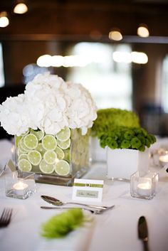 Not sure about the flowers, but I love the idea of a vase with lime slices or something similar