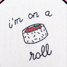 The words im on a roll in cursive with a piece of (spicy tuna) sushi are…