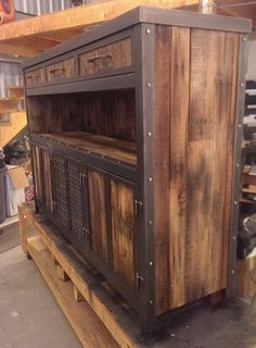 Rustic industrial media console with reclaimed wood by IndustEvo