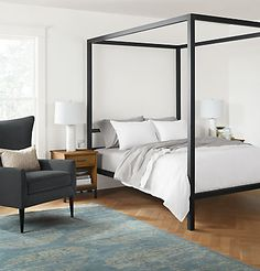 Strength and scale combine to create Architecture—a modern canopy bed with a dramatic presence.