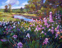 A river runs behind this garden of irises.