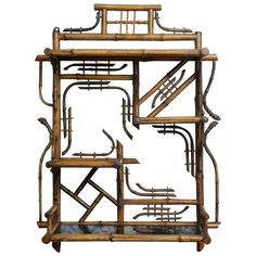 19th Century Bamboo Wall Étagère | From a unique collection of antique and modern shelves at https://www.1stdibs.com/furniture/storage-case-pieces/shelves/