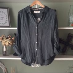 Anthropologie button-up Really cute and comfortable.  This classic style has a trendy lace section in the back. Gently worn. Anthropologie Tops Button Down Shirts