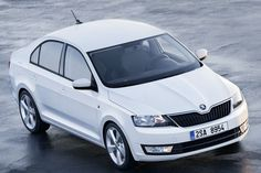 Skoda Rapid Photos and Specs. Photo: Skoda Rapid sale and 26 perfect photos of Skoda Rapid Diesel, New Luxury Cars, Upcoming Cars, Bike News, Skoda Fabia, Driving School, Car Prices, Latest Cars, Car Manufacturers