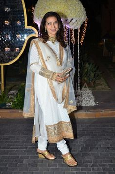Actress Juhi Chawla kept things simple in a white and gold churridar