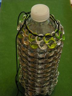 Upcycled can tab bottle holder. Insulates and draws attention.