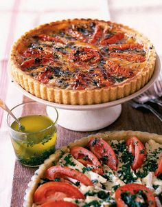 A flaky pastry crust plays host to Gruyère and Camembert cheeses, sliced plum tomatoes, and a fragrant herb oil in this showstopping savory tart.Recipe: Tomato and Camembert Tart Easy Brunch Recipes, Romantic Dinner Recipes, Easter Dinner Recipes, Summer Recipes, Dinner Ideas, Easter Dinner Menu, Romantic Dinners, Easter Brunch, Meal Ideas