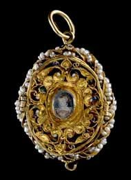 This gold locket  dates from the late 16th  century. Known as the 'Penicuik Jewels', they are said to have  belonged to Mary, Queen of Scots. They were long preserved by the  Clerks of Penicuik as relics of Mary.