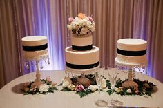 Cake trio on stands from The Sweet Life bakery in New Orleans.