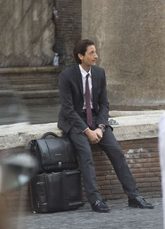 Adrien Brody with Piquadro trolley and bag