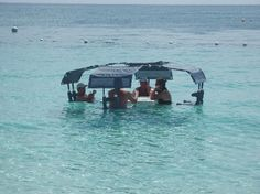 Floating table at the Ritz-Carlton in Grand Cayman  Very cool!  what a way to dine