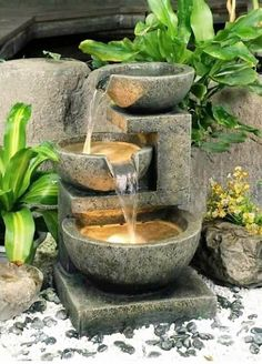 This kind of fountain is always popular and interesting among the waterfall lovers. This is nice and compact and can be placed anywhere in your garden. These stone and concrete pots or bowls with falling water are easy to assemble. The light inside the bowls is giving a magical effect to the water.