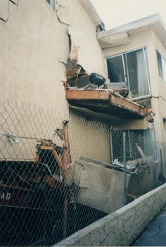 Earthquake damage at an apartment house in Sherman Oaks, Calif. after the Northridge earthquake of January 17, 1994. San Fernando Valley History Digital Library.