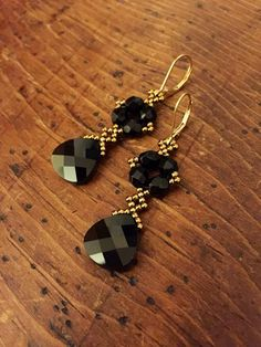 These sparkly Swarovski black crystal earrings feature a black jet Swarovski flat briolette, beadwoven with bronze glass seed beads and a cluster Black Jewelry, Black Earrings, Teardrop Earrings, Wire Jewelry, Beaded Earrings, Earrings Handmade, Beaded Jewelry, Jewelery, Jewelry Accessories