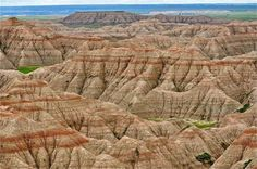Badlands National Park, South Dakota. Largest known collections of Eocene and Oligocene mammal fossils. Cretaceous Period also in a layer of rock called the Pierre Shale. http://www.nps.gov/badl/naturescience 80 miles east of Rapid City, South Dakota 57750. Phone (605)433-5361