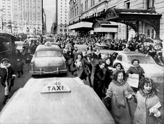 1964 New York City 59th Street Thousands of Beatle fans run against traffic trying to get a look at the Fab Four who are staying at The Plaza Hotel Photo by Judd Mehlman/New York Daily News