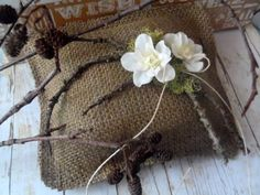 Country wedding ring pillow made out of woodland burlap.