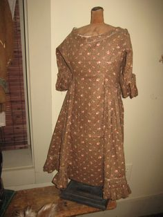 VERY EARLY CHILDS DRESS OF BROWN CALICO-JOAN LUCAS ANTIQUES