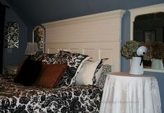 What an incredible idea!  She took a door and added molding on top with crown.