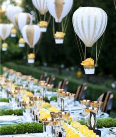 outdoor wedding lighting via petite hot air balloons carrying a yellow rose, great wedding centerpiece