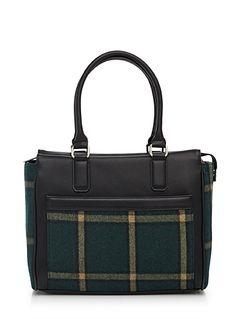 Exclusivité Simons     On aime ce sac bimatière façon cuir et laine au motif de tartan ultra tendance   Une forme structurée moderne qui s'agencera parfaitement à vos looks automnales.