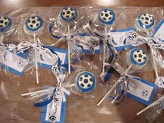 Oreo's dipped in white chocolate with blue frosting and soccer ball candy on top.