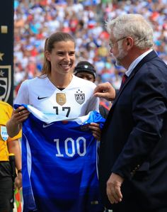 Tobin Heath is honored for having reached 100 caps. The ceremony took place before the United States' match against Haiti in Birmingham, Ala., on Sept. 20, 2015. (Marvin Gentry/USA Today Sports)