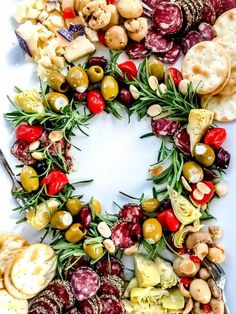 This quick and easy antipasto board appetizer shaped like a wreath is sure to add cheers, nibbles, and noshes to any festive Christmas potluck or party. Christmas Potluck, Christmas Cheese, Xmas Food, Christmas Appetizers, Christmas Cooking, Appetizers For Party, Appetizer Recipes, Merry Christmas, Christmas Catering