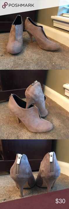 Call It Spring gray suede ankle booties Call It Spring gray suede ankle booties with faux zipper detail on the back.   These are amazing shoes for the fall  winter!  These are a size 10 and still have lots of life left in them.   Also available in black in another listing. Call It Spring Shoes Ankle Boots & Booties