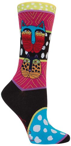 Laurel Burch is a well-known artist and a line of socks has been honored with images of her artwork. This style has two colorful cat faces with fuchsia decorated with gold thread, black and white polk