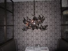 Stretched fabric acoustical wall panels in restaurant