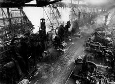 Les presses de Renault. Boulogne Billancourt 1936 ¤Robert Doisneau. Atelier Robert Doisneau   Site officiel