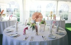 Tables w/ copies of The Great Gatsby and handmade napkins in mason jars.